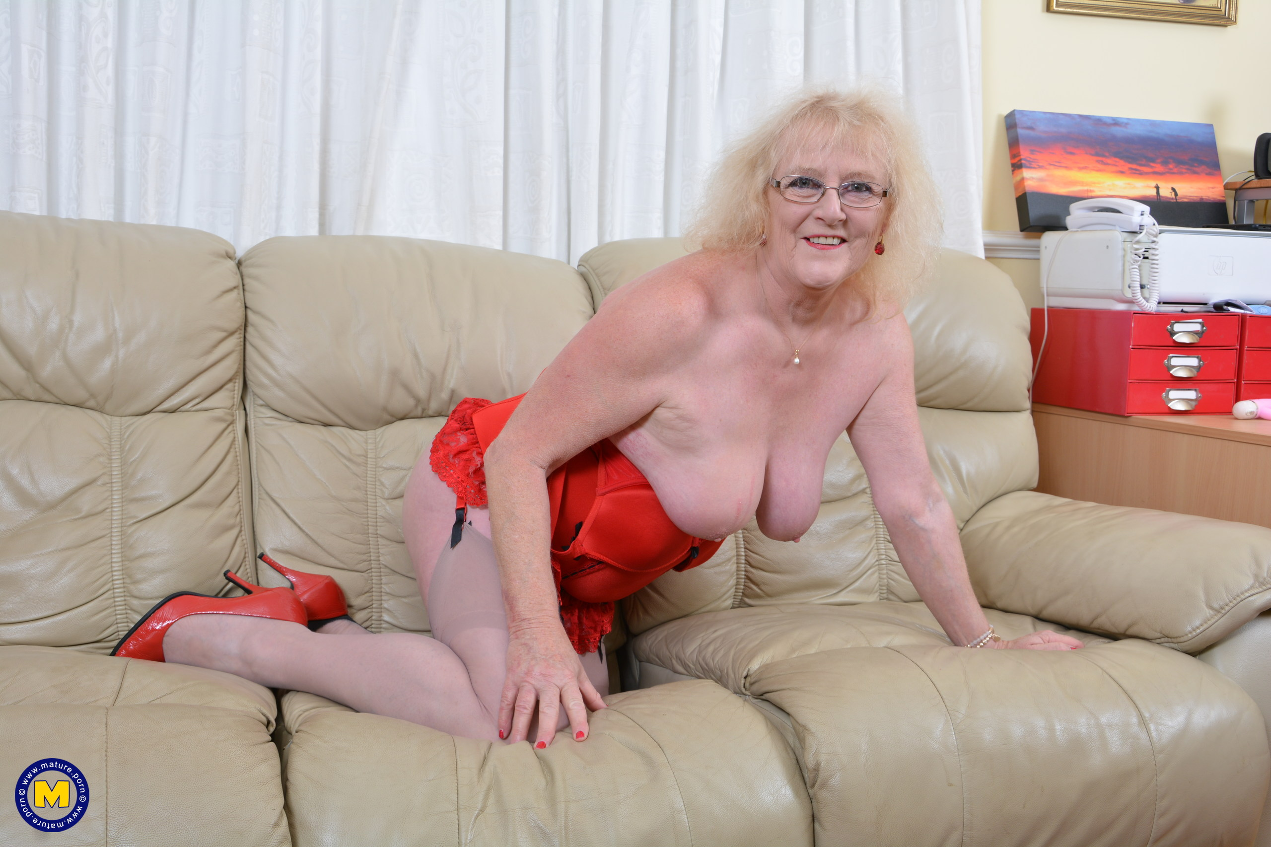 Nasty British mature woman getting moist on her couch