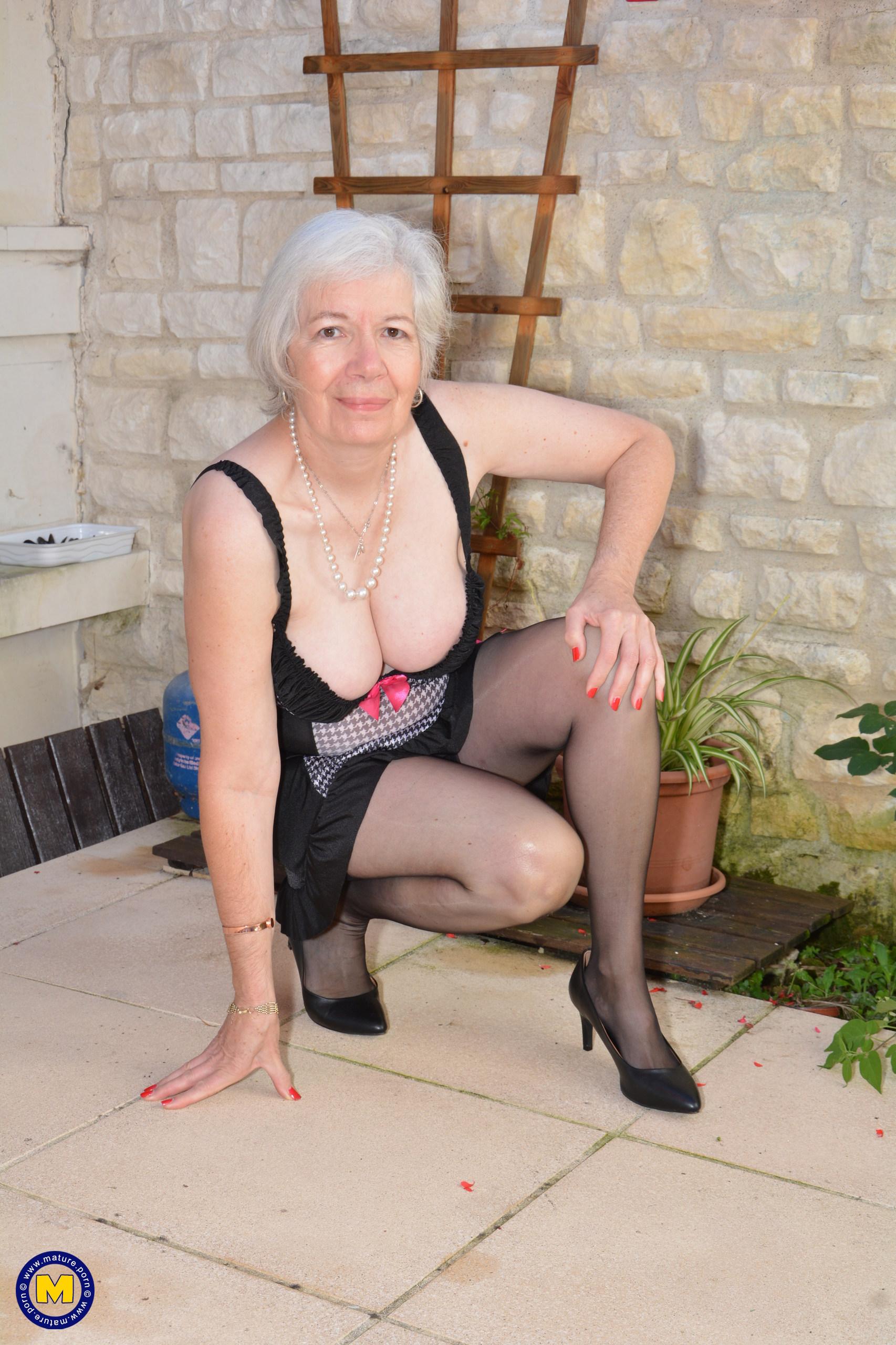 British grandma stroking in her garden